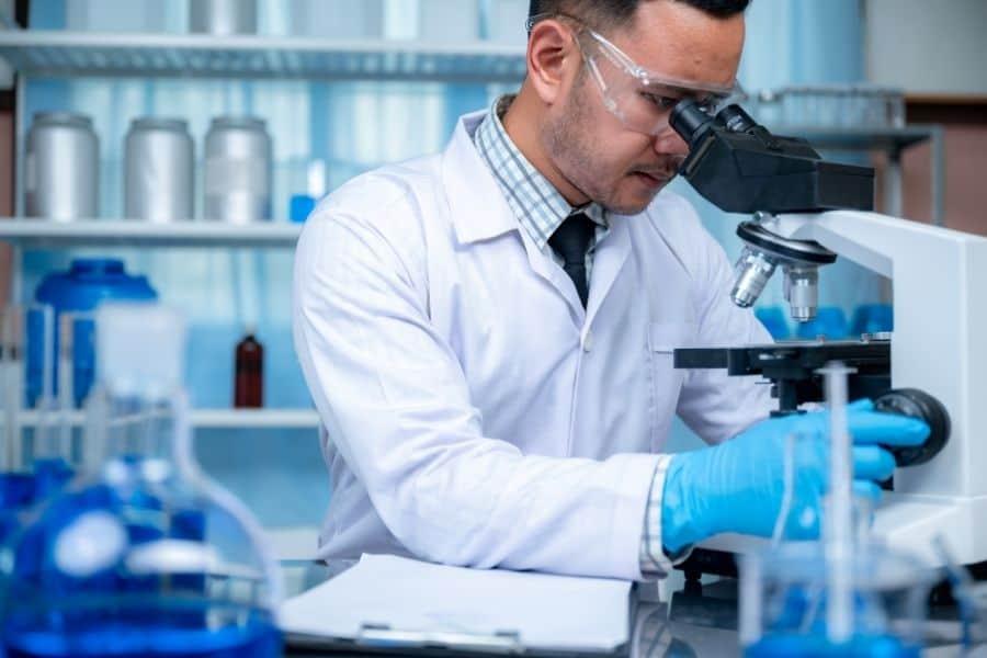 Man testing hair in lab