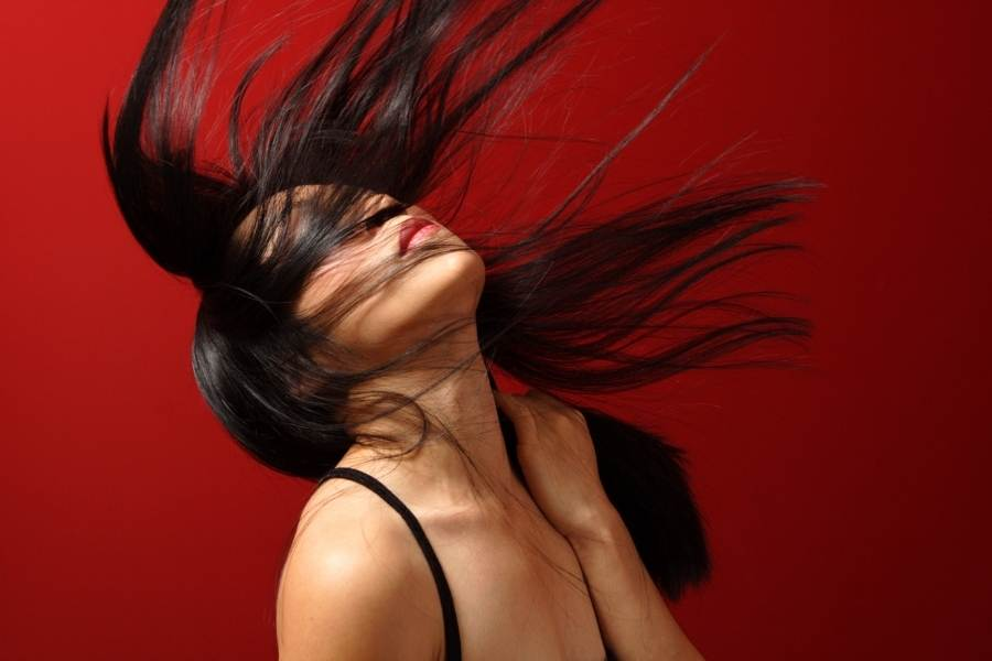 asian woman flipping hair