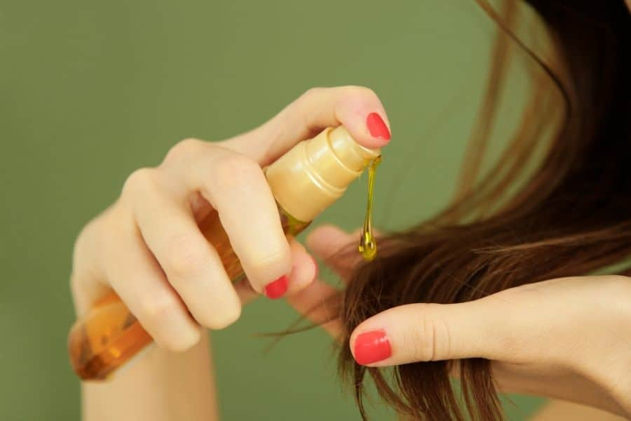 Woman using hair product